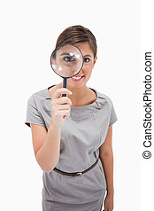 Woman using magnifier