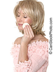 Woman using makeup applicator - A woman removing, applying ...
