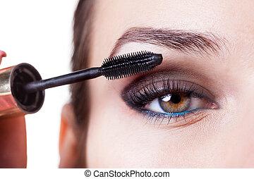 Woman using mascara - Young beautiful woman applying mascara...