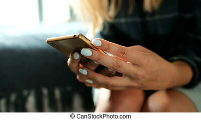 Woman using mobile phone 4k - Close up of woman using mobile...