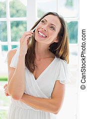 Woman using mobile phone at home