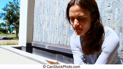 Woman using mobile phone in city 4k - Woman using mobile...