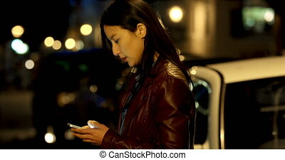 Woman using mobile phone in street 4k