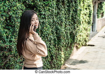 woman using mobile phone talking
