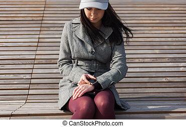 Woman using modern smart watch
