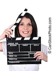 woman using movie clap