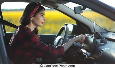 Woman using navigation app on smartphone in car