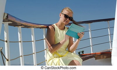 Woman using pad during sea traveling