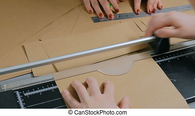 Woman using paper cutter, guillotine - Professional woman...