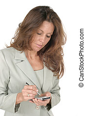 Woman Using PDA 1 - Attractive business woman using a pda,...