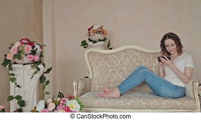 Woman using phone at home