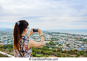 Woman using phone taking pictures