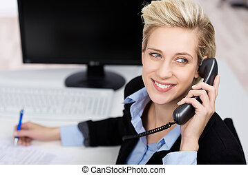 Woman Using Phone While Looking Up In Office