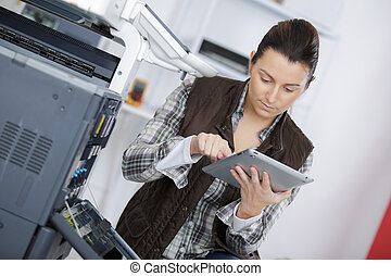 woman using printer in the office