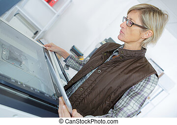 woman using printer on table