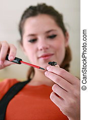 Woman using screwdriver