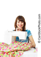 Woman using sewing machine to sew clothing - Seamstress ...