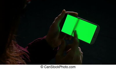 Woman using smart phone in the dark