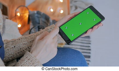 Woman using smart phone phone with green screen