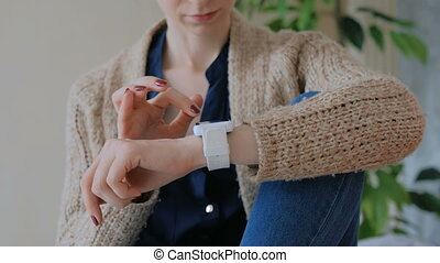 Woman using smart watch at home