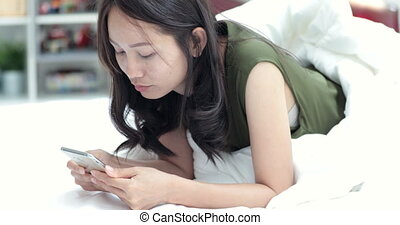 Woman using smartphone and relax at home