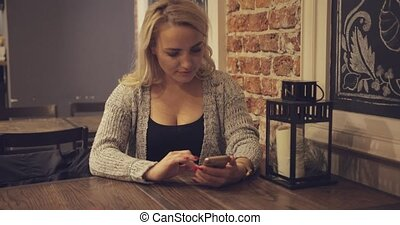 Woman using smartphone at table