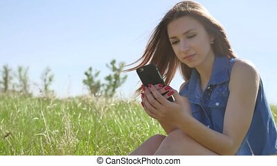woman using smartphone. Girl lifestyle social media on Internet on outdoors smartphone