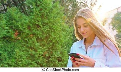 Woman Using Smartphone Looking Happy