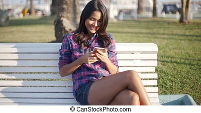 Woman Using Smartphone Outdoors.