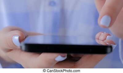 Woman using smartphone with touchscreen display - close up top view