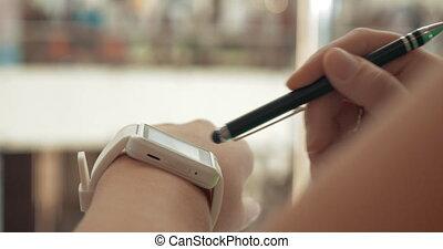 Woman using smartwatch in city street