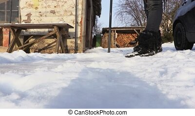 Woman using snow shovel in snow covered yard