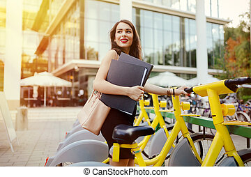 Woman using solar city bike