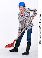 Woman using spade