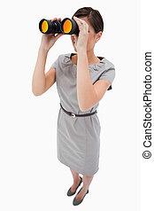 Woman using spyglasses