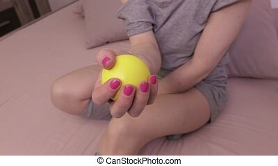 Woman using stress ball