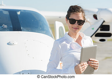 woman using tablet in airport