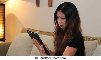 Woman Using Tablet In Home