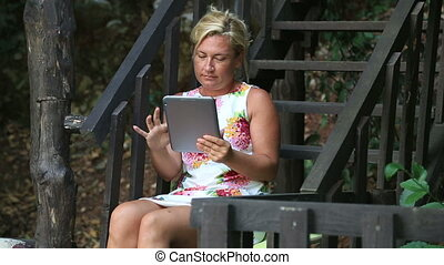 woman using tablet outdoor