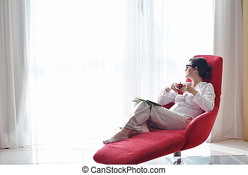 woman using tablet pc at home