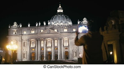 Woman using tablet PC to capture St. Peters Basilica