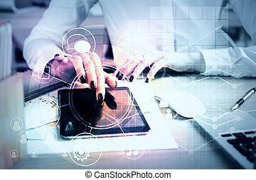 Woman using tablet with business diagram