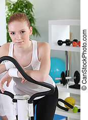 Woman using the stepper machine
