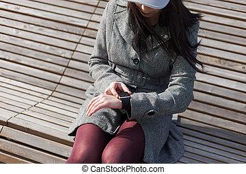 Woman using trendy smart watch