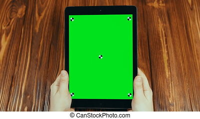 Woman Using Vertical Tablet With Green Screen