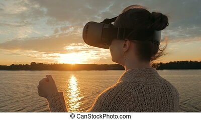 Woman using virtual reality glasses on deck of cruise ship...