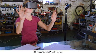 Woman using virtual reality headset at workshop 4k