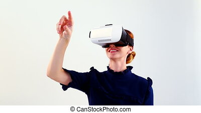 Woman using virtual reality headset on chair 4k