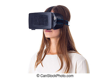 Woman using VR glasses - Young nice woman in white shirt...