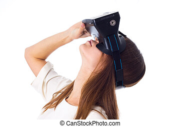 Woman using VR glasses - Attractive young woman in white...